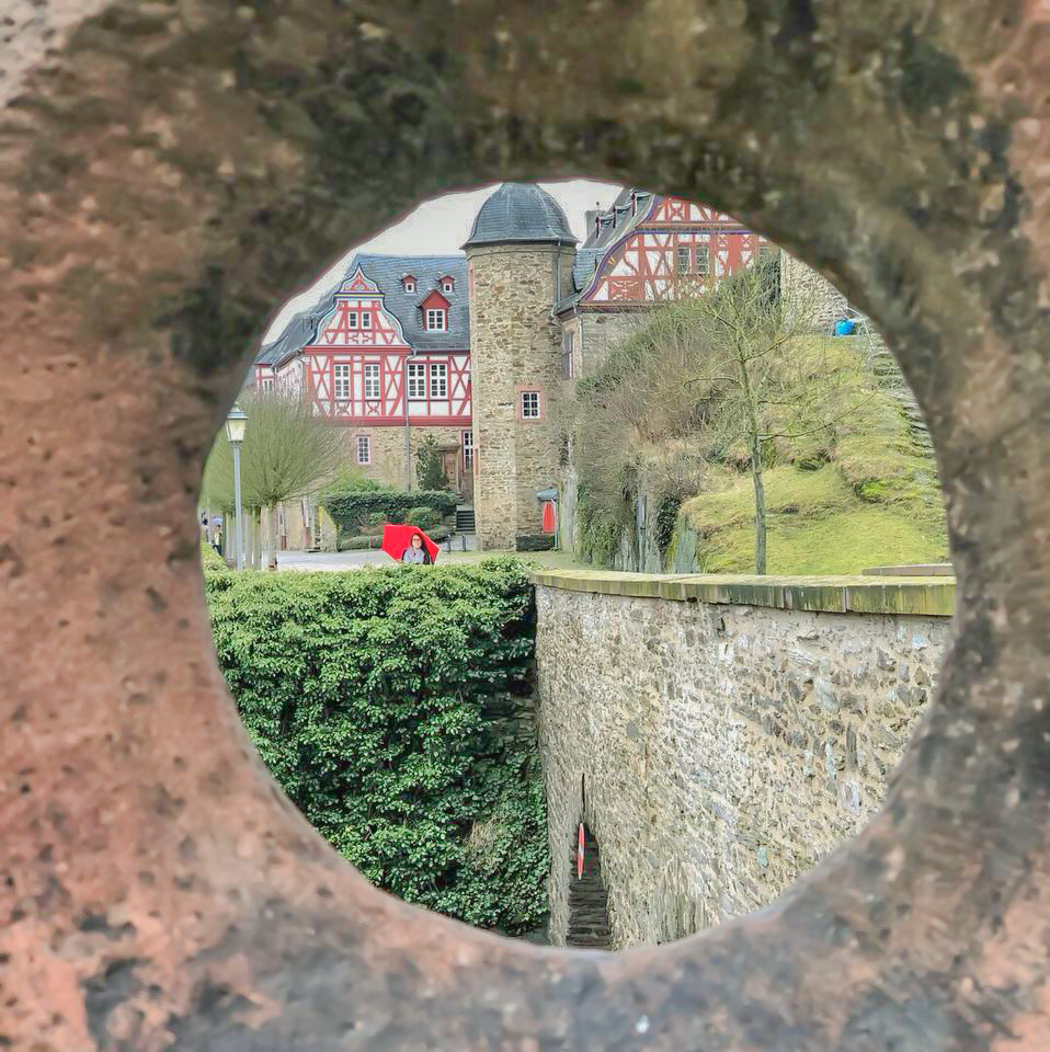 girl with a red umbrella on the road trip around Southern Germany in Idstein, Germany