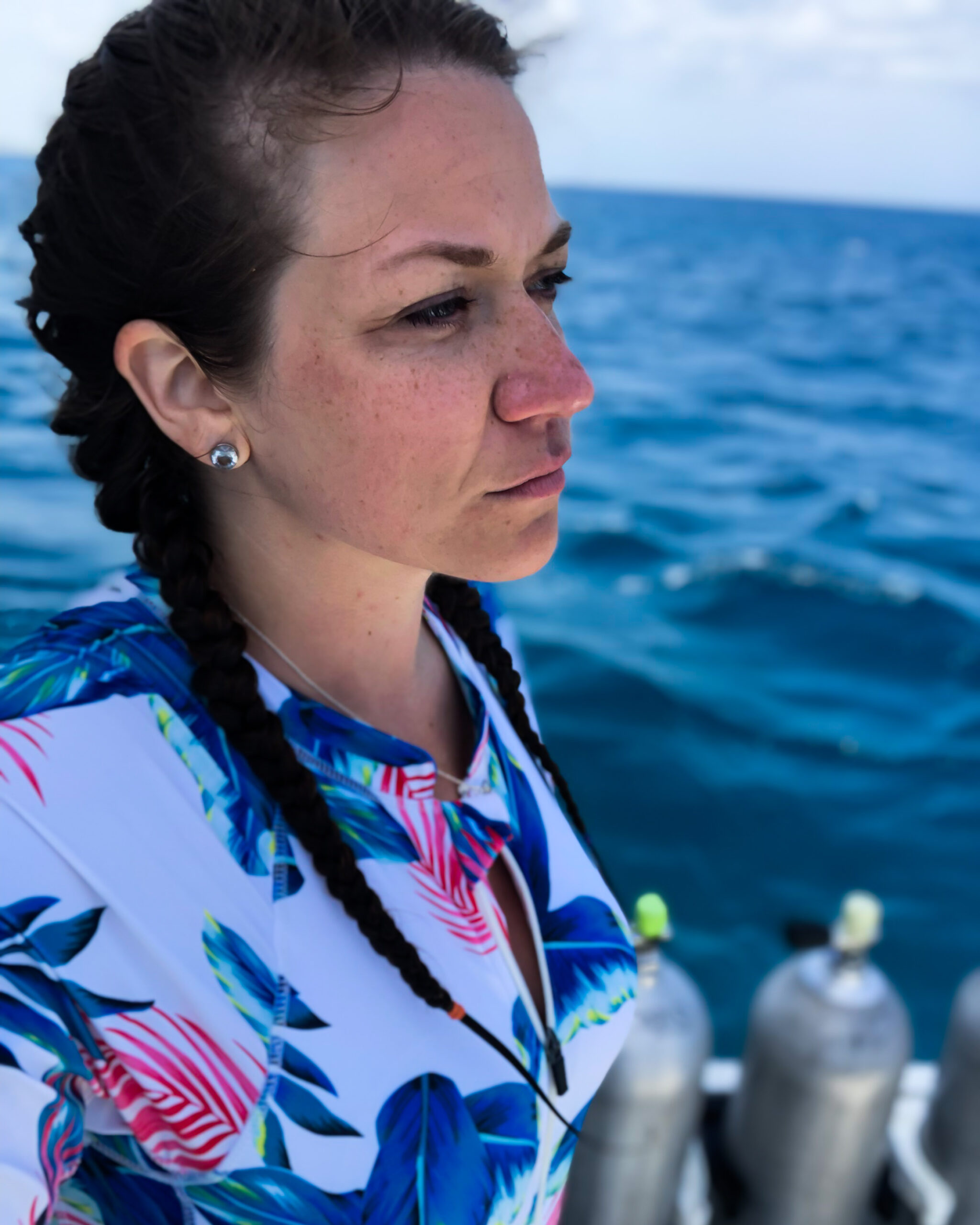 girl in Aruba before scuba diving she has braided hair to avoid a tangled mess